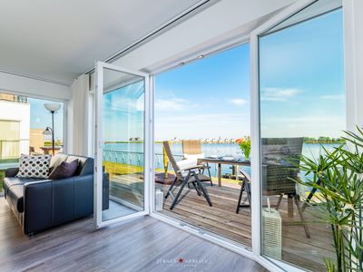 Photo for This luxury apartment is on the water with a sauna, a large sun terrace
