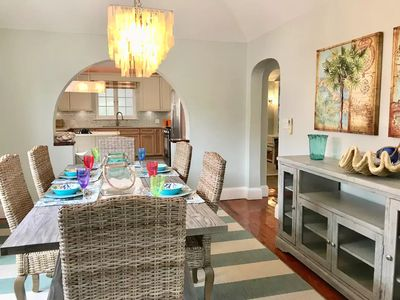 Elegant, sea-side style dining room located just off the large, stylish kitchen.