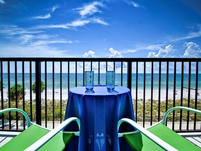 Relax and enjoy a beverage as you delight in the stunning view.
