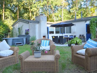 Photo for Detached villa with enclosed wooded garden with lawn, jacuzzi and infrared sauna