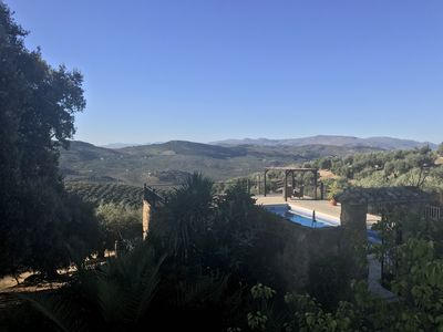 Far reaching views of olive groves and mountains