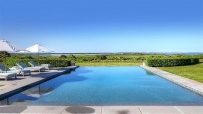 Endless Water Views From This Waterfront Estate With Beach & Infinity Pool