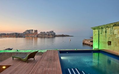 Photo for Iconic Valletta 4-bedroom Seafront house and pool