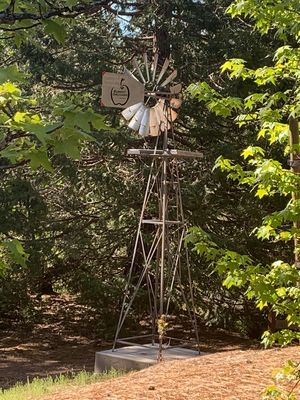 Our charming windmill rotates gently in the breeze.