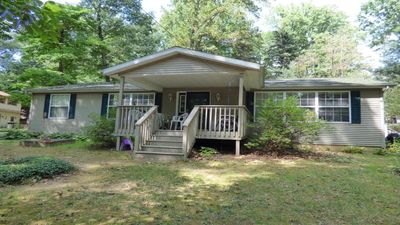 Photo for Family-friendly Comfortable Cottage Nestled In The Trees, Steps From The Lake