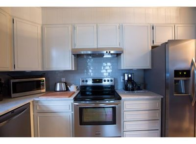 New stainless steal appliances make the kitchen easy to work in.