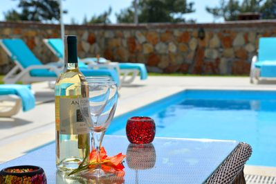 Enjoy a cool glass of wine, by the stunning private pool