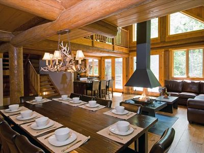 Dining area with 4-sided glass fireplace, living area. Spectacular views!