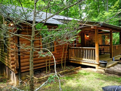 Photo for Cozy log cabin with easy access and hot tub. Close to all the activities.