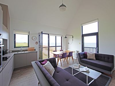 Photo for Spacious luxury 4 Bed apartment perfect for groups, stunning views over the Pentland Firth.