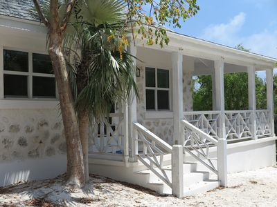 Photo for Cozy stone studio cottage on private pink sand beach