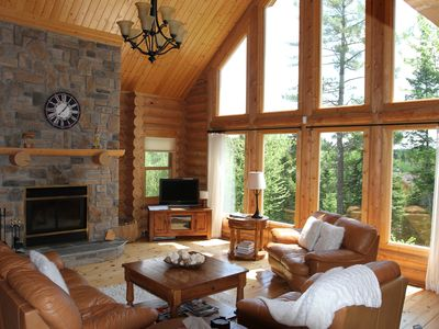 Photo for 4BR Chalet Vacation Rental in Mille-Isles, QC