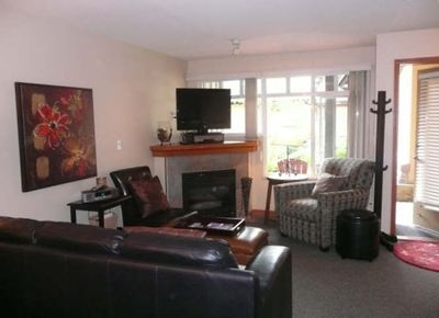 Cosy Living area, two chairs, leather sofa bed.  Front patio, across from pool!