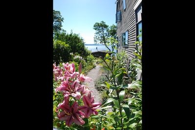 Wind your way down the garden path to The Perch and the view beyond.