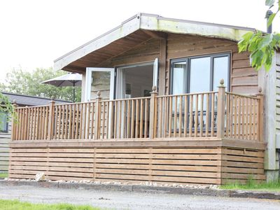 Photo for Maple Tree Lodge with private hot tub, close to beach with countryside views