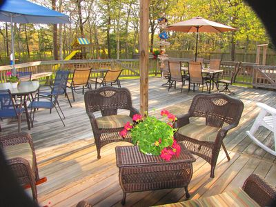 Fabulous back deck with plenty of furniture!