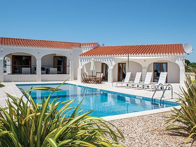 Photo for Modern beach villa with enticing pool + free A/C & Wi-Fi throughout