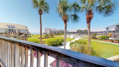 "Photo for Stroll to the State Park, and relax poolside! Dog-friendly 2BR/2.5BA Ocean Mile, free Beach Gear, WiFi.  great value! ""Ocean Mile J-8"""