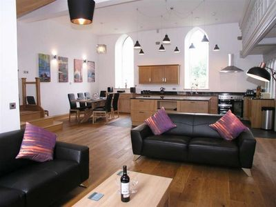 The lounge, dining and kitchen area.