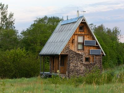 Solar-powered riverside cabin close to the sea