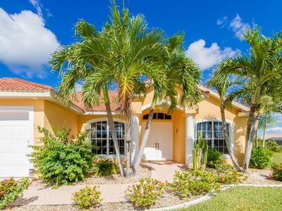 Photo for SW Cape Coral | Gulf Access | Quiet neighborhood, canal view, boat dock with Tiki Hut