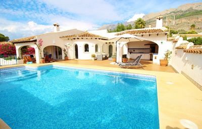 Photo for Dream villa with private tennis court, pool, sea and mountain views and green garden