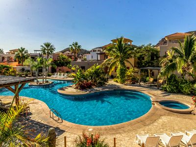 Photo for Charming home w/ terrace, great views & 3 shared pools - steps to the beach!