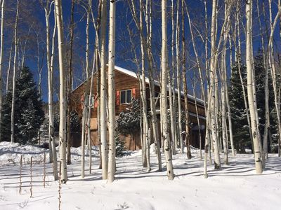 The house is cedar/ stucco SW design, surrounded by Aspens and Evergreens