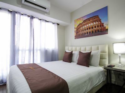 Photo for SIGLO SUITES @ ACQUA 1BR Superior Livingstone 1403