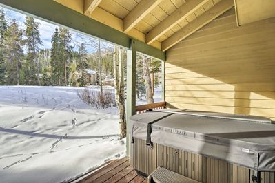 Stay warm while soaking in the townhome's private hot tub.