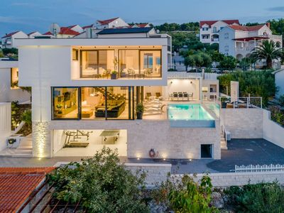 Photo for Modern luxury villa with pool and sea view. Near the beach !