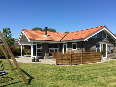 Photo for Holiday home, spa and steam bath, sauna, internet, near forest, 75 m to the beach