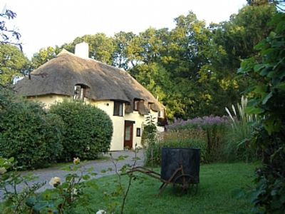 Photo for Picturesque Thatched 4 bedroomed Cottage  between Quantock Hills and Sea