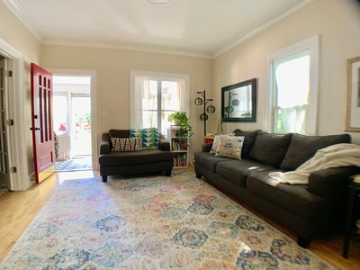 """Large living room with access to 3 season porch and a 50"""" smart tv."""