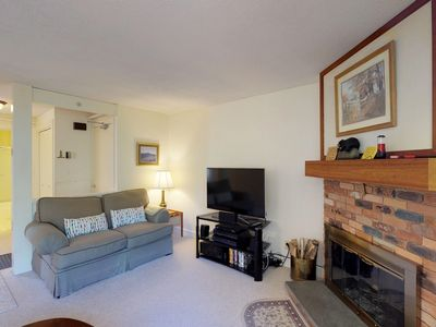 Photo for Comfortable condo w/ shared pool and clubhouse fitness room, forest views!