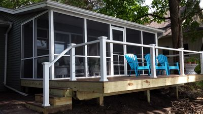 Main house suite screened porch and deck.