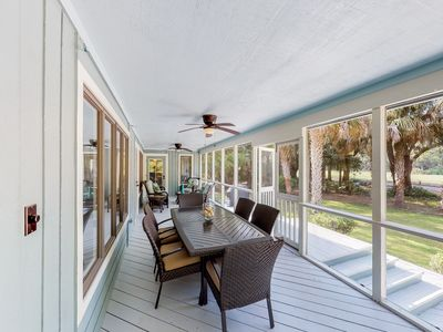 Photo for Golf-course-front home w/ huge screened porch - bike to the beach!