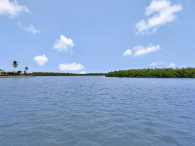 Photo for Waterfront house on key lot w/ large heated pool and view of Marco River