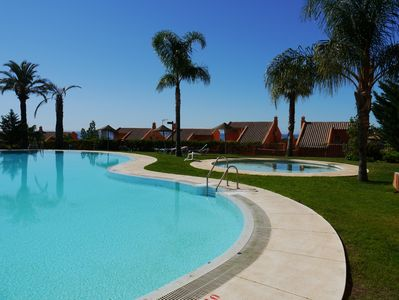 Main Pool and Baby Pool Edged with Palm Trees