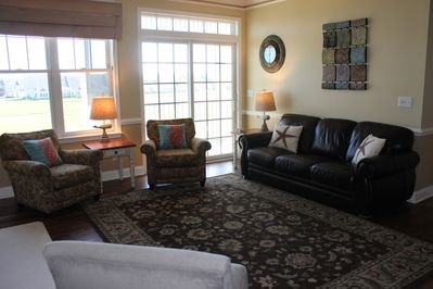 living room with access to deck