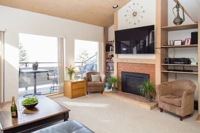 Top-of-the-line entertainment center with 65' Ultra-HD and gas fireplace.