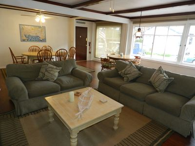 Queen sleeper sofa, dining table seats six plus a game table seating 4.