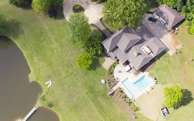 Photo for Ivy Springs Retreat. Private Lake,  pool, hot tub. Minutes from town & vineyards