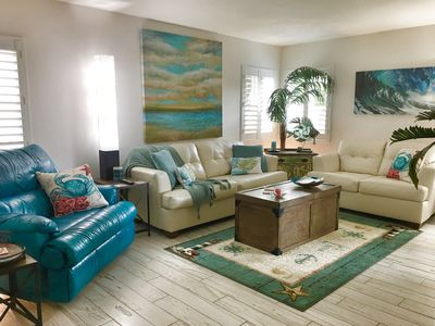 Living Room: Plenty of seating and a recliner for 2. Fun beach themed decor.