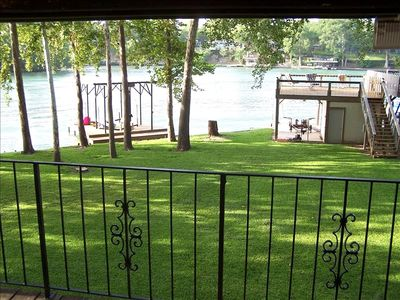 View of waterfront from Master Bedroom deck with table and chairs