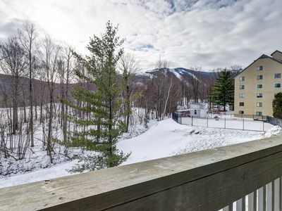 Photo for NEW LISTING! Cozy condo w/ shared pools, hot tub, & sauna, on ski shuttle route!