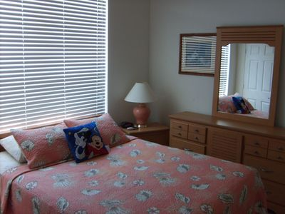 First floor bedroom , queen size bed , attached full bathroom , flat screen TV .
