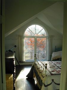 Master bedroom with beautiful view of meadow and stream