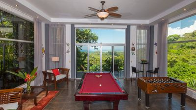 Game room with pool table and foos ball.