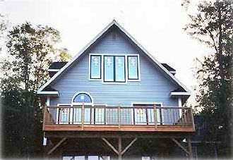 Lakefront Elevation, Lower Level Porch and Walkout to Lake Not Included in Photo
